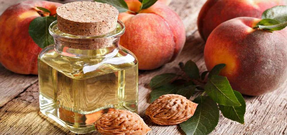 Персиковое масло: свойства и применение