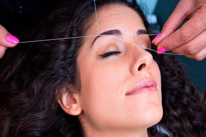 Выщипывание волос нитью
